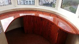 Встроенная мебель для объедененного балкона